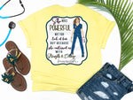 Southern Nurse Tees - living life in scrubs - shirts with sayings - she was powerful not for lack of fear but because she continued on with strength and courage - nurse holding n95 mask - superhero nurse t-shirt - covid 19 coronavirus covid corona tee - inspirational preppy top - cute brunette LPN RN - simply a yellow graphic tee