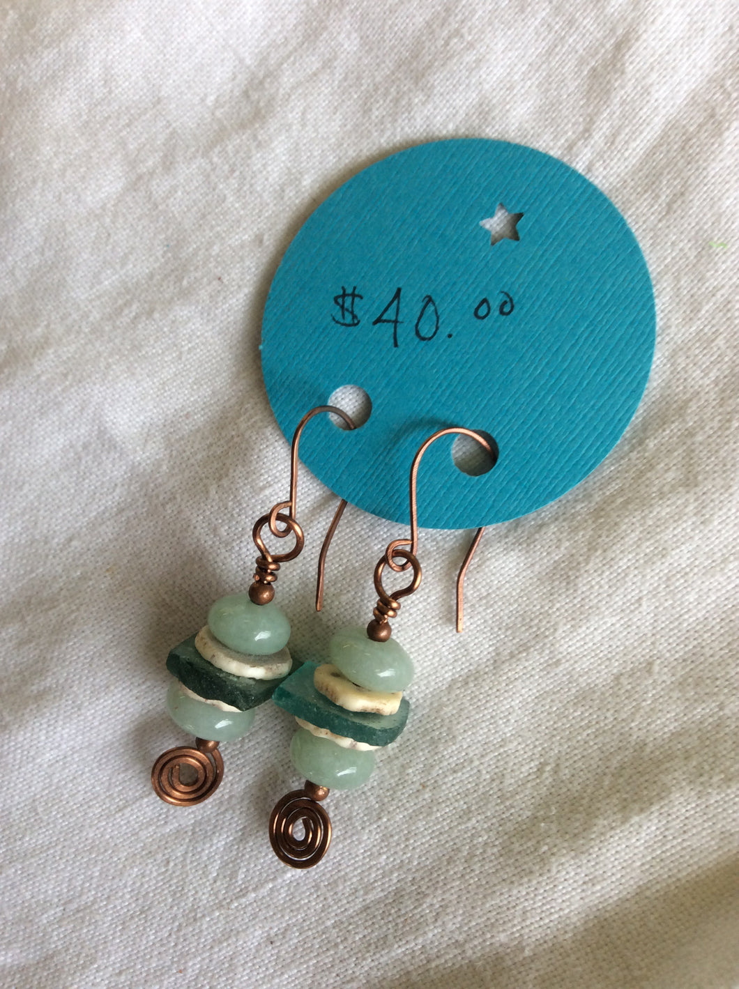 Copper, Ancient Roman glass, ostrich egg shell, and aventurine earrings.