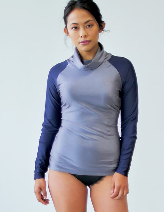 woman wearing grey cowl neck iaera surf rash guard