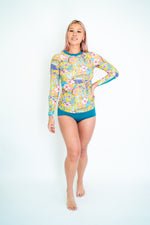 The TANI Rash Guard in Medallion & Teal