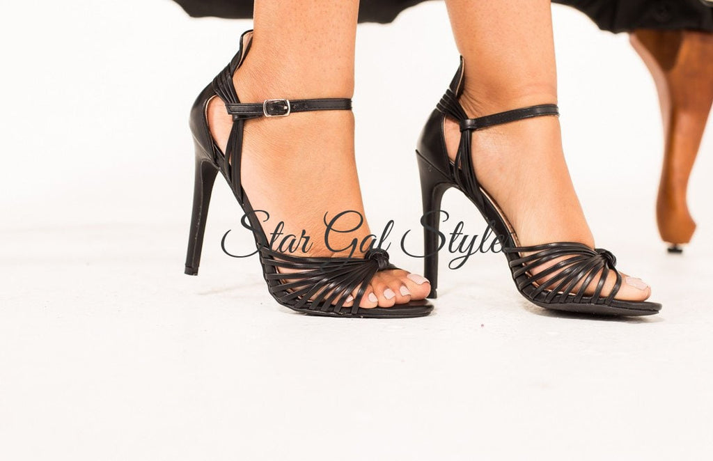 Let's be honest, these gorgeous heels are a must have for every chic woman. The Gigi black heels are great for formal events, party and the after party, and everything beyond. Gigi features an open toes, stiletto heel, strappy front construction, ankle strap for securing on feet and a lightly padded insole for comfort. Available in rose gold and black.