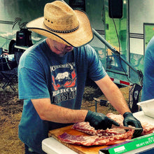 Johnny Ray prepping ribs at a kcbs bbq competition.