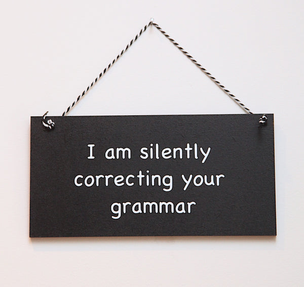 Grammar hanging sign