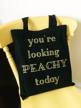 Metallic gold typography Peachy cotton black tote bag