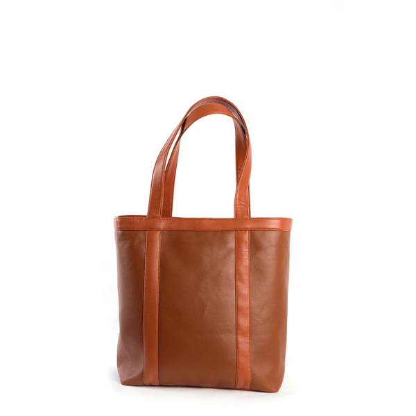 Whiskey brown, vegan leather tote. Perfect for grocery shopping or a bike ride to the beach.
