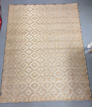 tan and silver rug