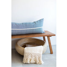 Azulina Home - Handmade Santa Marta Macrame Throw Blanket styled in basket next to wood bench with blue pillow