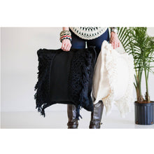 Azulina Home - Handmade Santa Marta Macrame Toss Pillow in Black being held by boho person with an ivory pillow too