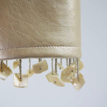 Sparkling Champagne Faux Leather Cuff with Shell Dangles