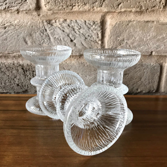 Set of three glass candle holders