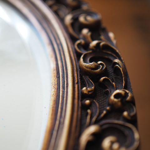 HEAVY DECORATIVE WORN GOLD MIRROR