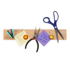 magnetic holder with lists and scissors attached