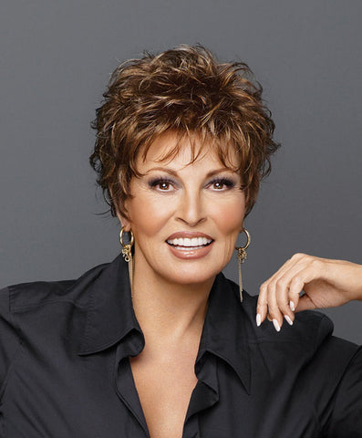 Raquel Welch Whisper  A barely-there boy cut with gently waved layers on top that blend to smooth sides and back. Only 1 ¾ ounces in weight, it's as soft and light as a whisper!     Memory Cap® Vibralite® Synthetic Hair