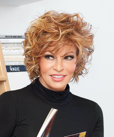 Raquel Welch Chic Alert  Soft, loose curls add volume and style to this above the shoulder, stacked bob. The Sheer Indulgence™ lace front means the bangs can be combed onto the face for softness or brushed back for a more cosmopolitan look. Tru2Life® heat friendly synthetic hair provides even more styling options.     Sheer Indulgence™ Lace Front Memory Cap® II Base Tru2Life Heat Styleable Synthetic Hair