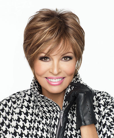 Raquel Welch Cover Girl  Generous length on top combined with all over precision layering and tapering gives a modern accent to the traditional boy cut. The Sheer Indulgence™ lace front monofilament top allows for off-the-face styling, parting versatility and a light, cool fit.     Sheer Indulgence™ Lace Front Monofilament Top Memory Cap II base
