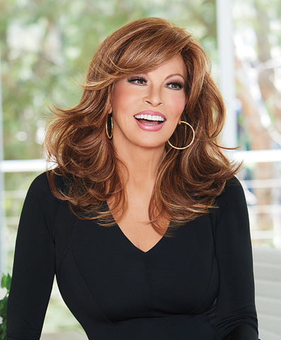 Raquel Welch Curve Appeal  This ultra- feminine silhouette features long, softly waved layers in the front and sides that graduate into longer layers that fall to mid-back. A Sheer Indulgence™ lace front monofilament part offers off- the -face styling and parting flexibility plusTru2Life® heat friendly synthetic hair provides added styling options.     Sheer Indulgence™ Lace Front Monofilament Part Memory Cap® II Base Tru2Life Heat Styleable Synthetic Hair