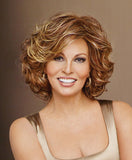 Raquel Welch Embrace  Oodles of long layers that fall to the shoulder define this soft feminine cut. Wear it curly, barely waved or whatever way suits you. Tru2Life® synthetic hair makes your styling options limitless!     Memory Cap® II Tru2Life Heat Styleable Synthetic Hair