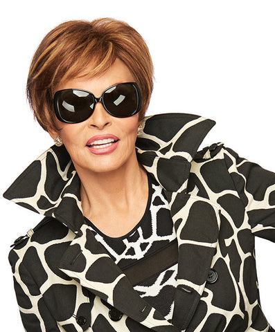Raquel Welch Excite  Why not borrow from the boys with this modern (and very feminine!) riff on a boy cut? Beautifully cut layers and a tapered neck mix downtown cool with uptown style.     Sheer Indulgence™ Monofilament Top Memory Cap® Base Vibralite® Synthetic Hair