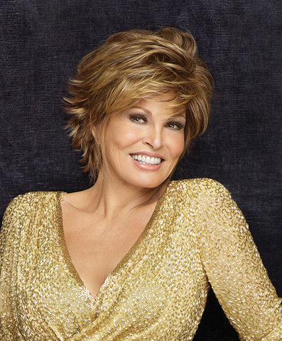 Raquel Welch Fascination  Weighing only 2 ½ ounces, this attractive boy cut features ample length in the top and extended nape and textured ends that can be styled with soft waves or super straight. OurTru2Life® heat friendly synthetic hair gives you added styling options!     Sheer Indulgence™ Lace Front Memory Cap® II Base Monofilament Part Tru2Life Heat Styleable Synthetic Hair
