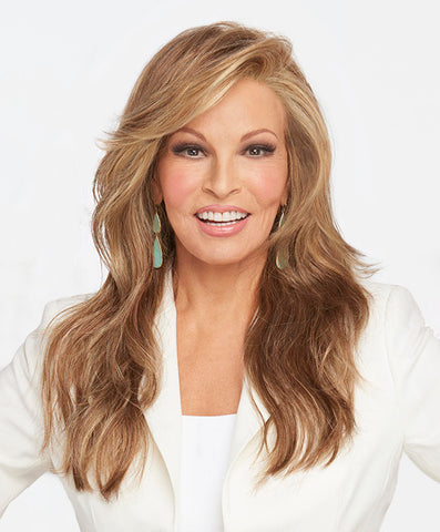 Raquel Welch Miles Of Style  Long layers fall to mid-back to create this full, flowing silhouette. Each softly sculpted wave is designed to add interest and movement to this long style. The Sheer Indulgence™ lace front monofilament part allows for off-the-face styling, and parting options.Sheer Indulgence™ Temple to Temple Lace Front Monofilament Part Memory Cap® III Base Vibralite® Synthetic Hair