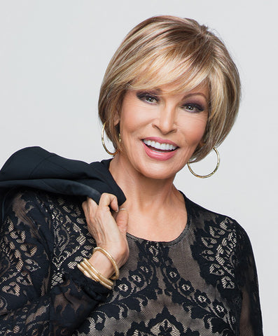 Raquel Welch Muse  A woman can be elegant without being stiff. This chic salon look is the polar opposite of (ugh) yesterday's helmet head. Today's best short length—but long enough to allow movement and add volume. Casual bangs make flirting a must. Muse is one of the Raquel Welch Wig Collection's timeless classics.     Sheer Indulgence™ Lace Front Monofilament Top 100% Hand-Knotted Base Vibralite® Synthetic Hair