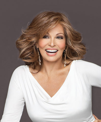 Raquel Welch Goddess  With a Sheer Indulgence™ lace front for the option of off-the-face styling and a monofilament top for varied parting choices, this barely waved, layered, shoulder length silhouette can also be curled for a more dramatic effect.     Sheer Indulgence™ Lace Front Monofilament Top Memory Cap® II Base Tru2Life Heat Styleable Synthetic Hair