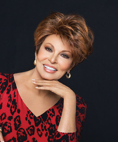 Raquel Welch Fanfare  This classic silhouette features full, precision-cut layers on the top and sides that smooth to a neck-hugging nape. The combination of our Tru2life® heat-friendly synthetic hair and a Sheer Indulgence™ lace front monofilament top means your styling options are virtually limitless!     Sheer Indulgence™ Lace Front Monofilament Top Memory Cap® II Base Tru2Life Heat Styleable Synthetic Hair