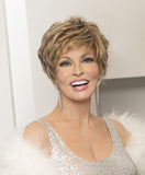 Raquel Welch Sparkle Elite  This short, face-framing cut offers the same style and comfort features as our popular Sparkle wig with the added luxury of a lace front monofilament top for off-the-face styling and a light, cool fit. Ready-to-wear with a firm shake right out of the box, Sparkle Elite includes a smooth front & top that blend into short textured layers throughout the back and sides.Sheer Indulgence™ Temple to Temple Lace Front Monofilament Top Memory Cap® II Base Vibralite® Synthetic Hair