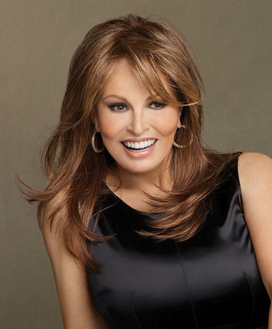 Raquel Welch Spotlight  Loads of long layers that fall to mid-back define this soft feminine cut. Wear it curly, barely waved or whatever way suits you. The Sheer Indulgence™ lace front monofilament top and Tru2Life® synthetic hair makes your styling options limitless!     Sheer Indulgence™ Lace Front Monofilament Top Memory Cap® II Base Tru2Life Heat Styleable Synthetic Hair