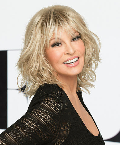 Raquel Welch Stop Traffic  Texture and movement are the inspiration for this blunt, to-the-shoulder bob. A soft, razor cut fringe frames the eyes while tousled and loose curls are layered throughout for natural volume and an unconstructed look. The Sheer Indulgence™ monofilament crown provides a natural contour.Sheer Indulgence™ Monofilament Crown Memory Cap® III Base Vibralite® Synthetic Hair