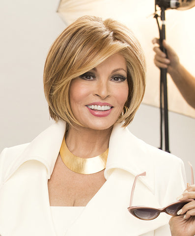 Raquel Welch Straight Up With a Twist  The classic bob meets modern day texture! This face-framing bob is punctuated with a softly sculpted nape that features razor cut tapering for a tailored but edgy feel. The Sheer Indulgence™ lace front monofilament top and Tru2Life heat-friendly fiber mean styling options are virtually limitless!     Sheer Indulgence™ Temple to Temple Lace Front Monofilament Top Memory Cap® II Base Tru2Life Heat Styleable Synthetic Hair