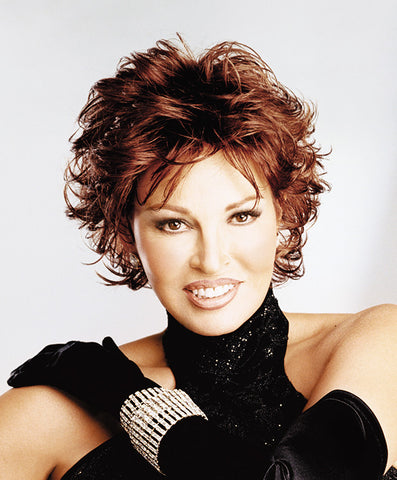Raquel Welch Tango  With short all over layers and a Sheer Indulgence™ Top, this sophisticated salon cut is the epitome of easy and varied styling options. Classic, yet exotic—like the Tango!     Sheer Indulgence™ Monofilament Top Memory Cap® Base Vibralite® Synthetic Hair  Cap Size: Petite Average