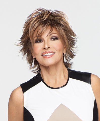 Raquel Welch Trend Setter  Loaded with layers, this mid-length shag adds fashion excitement with flipped textured ends throughout. A quick shake right out of the box and this cool, comfortable cut is ready-to-wear!     Memory Cap® II Vibralite® Synthetic Hair