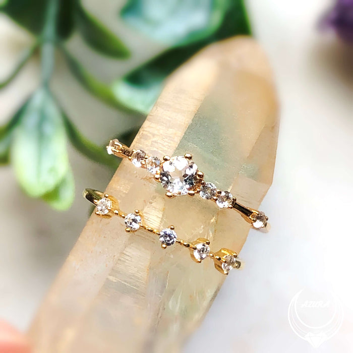 The Center of the Universe Ring (Yellow Gold) & White Topaz Celestial Ring (Yellow Gold)