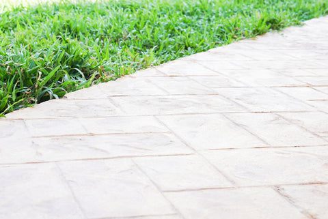 Everything You Need To Know About Stamped Concrete stamped concrete next to grass