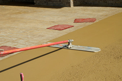 Everything You Need To Know About Stamped Concrete spreading wet concrete
