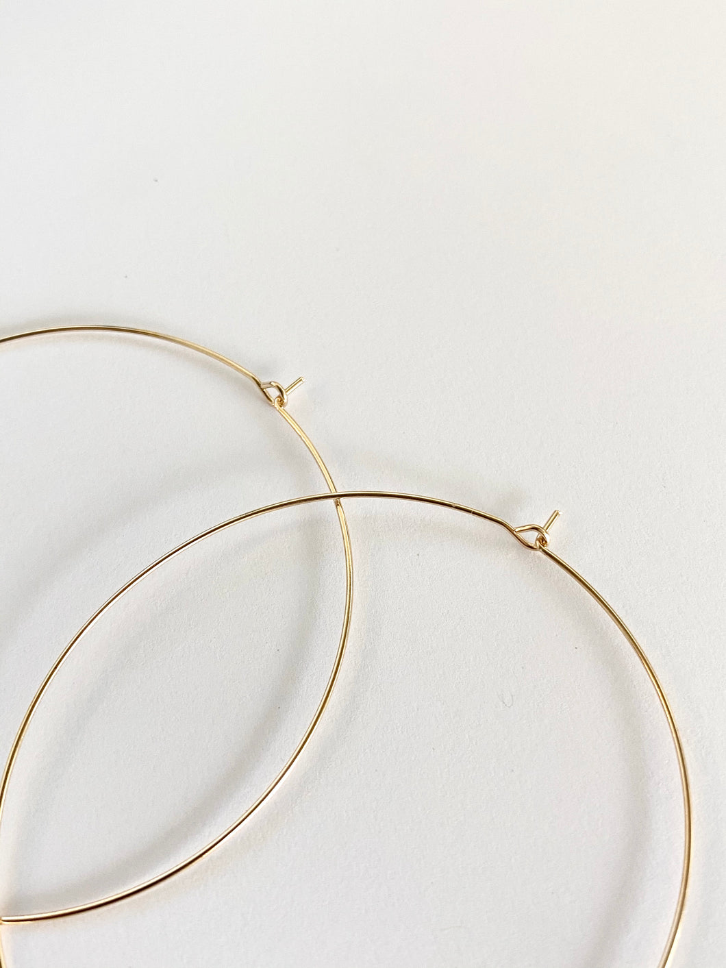 Very thin gold plated hoops earrings