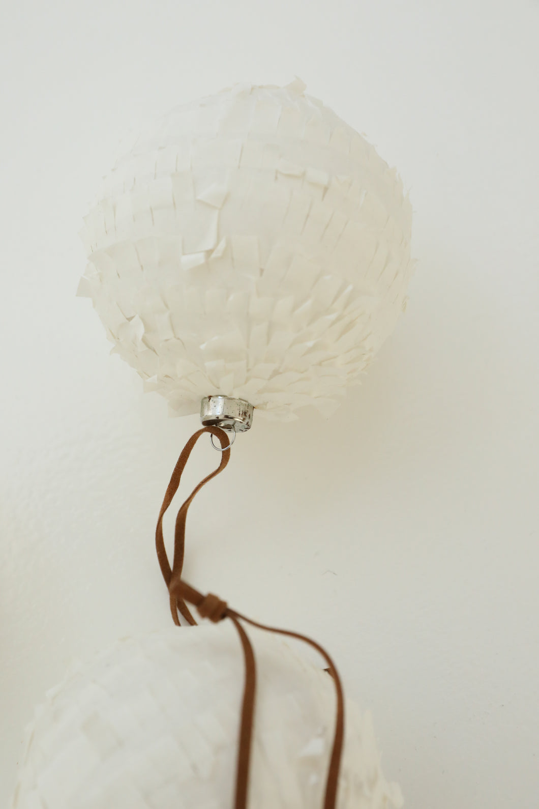 white paper hanging ball ornament