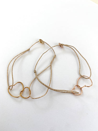 attached hearts bracelet on lurex string