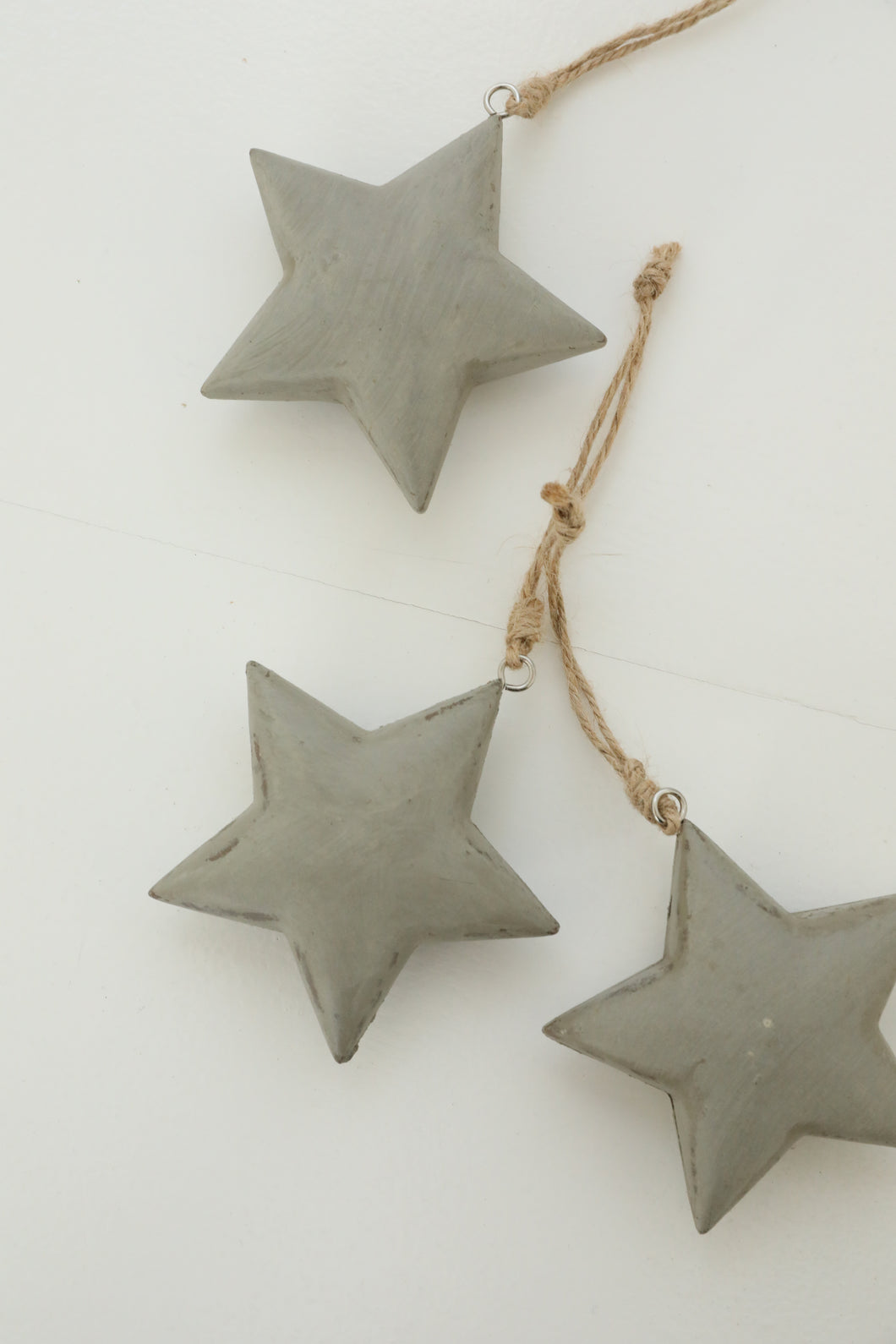 grey hanging star with earthy thread