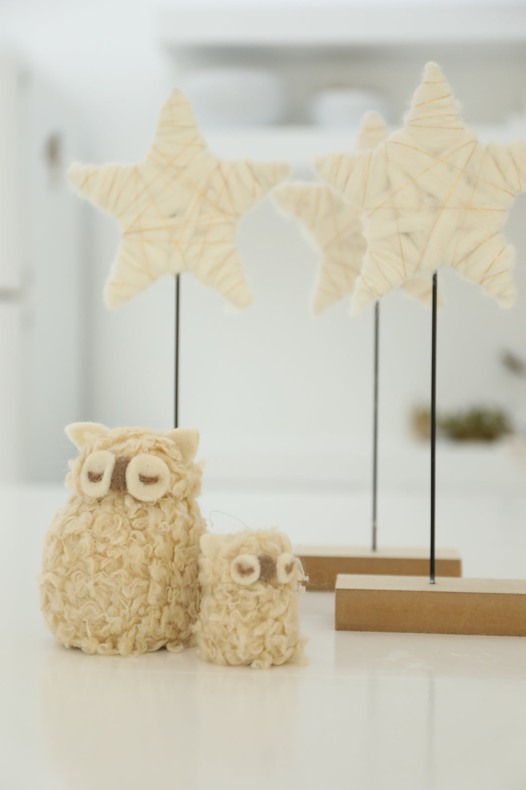 cream furry hanging woolly owl