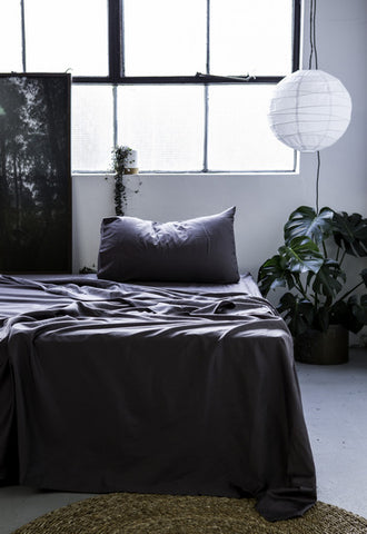 slate-grey-bed-with-hanging-light