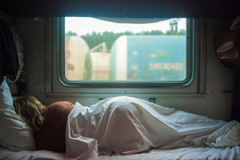 woman-asleep-on-bed-in-caravan