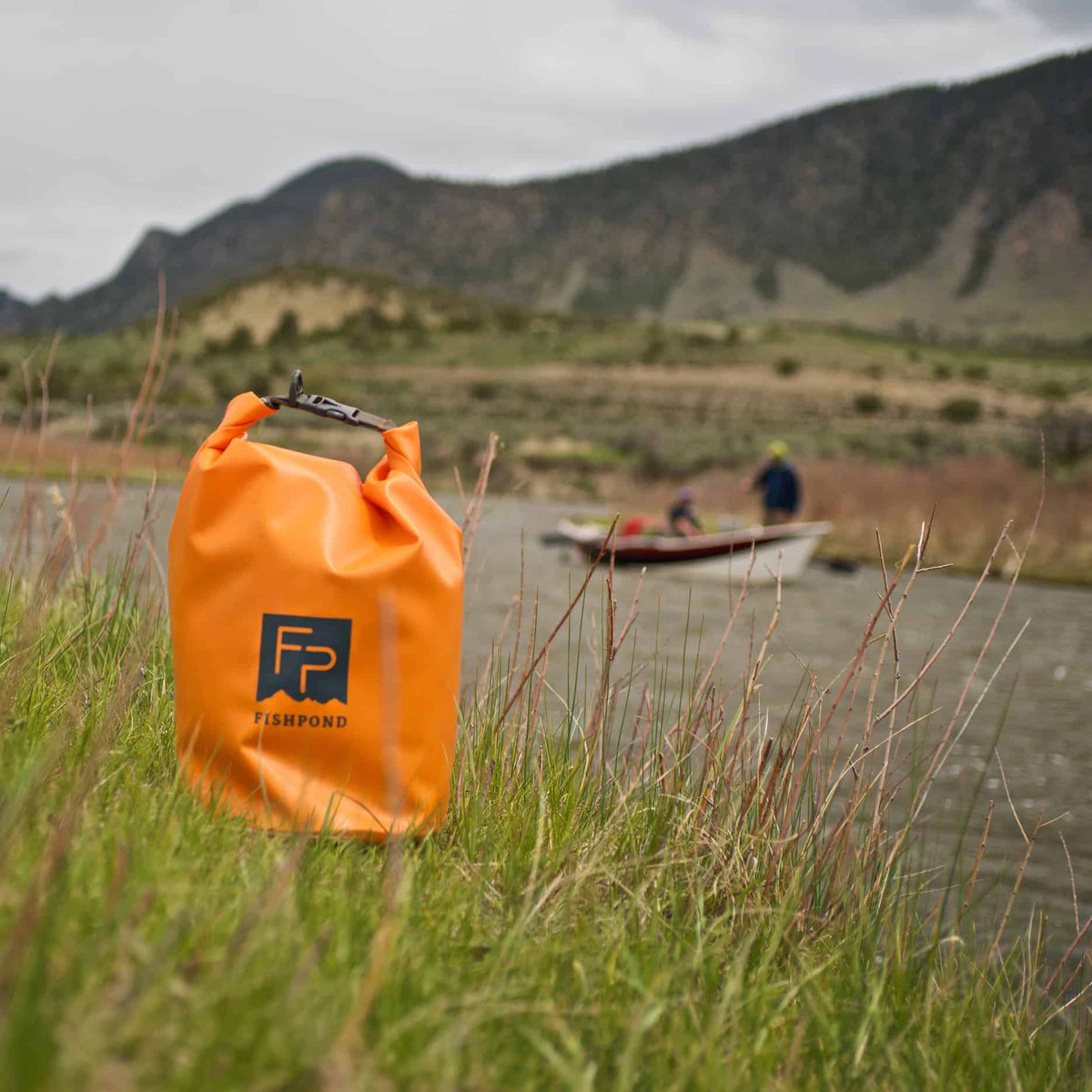 Fishpond Thunderhead Roll Top Dry Bag Cutthroat Orange On Bank
