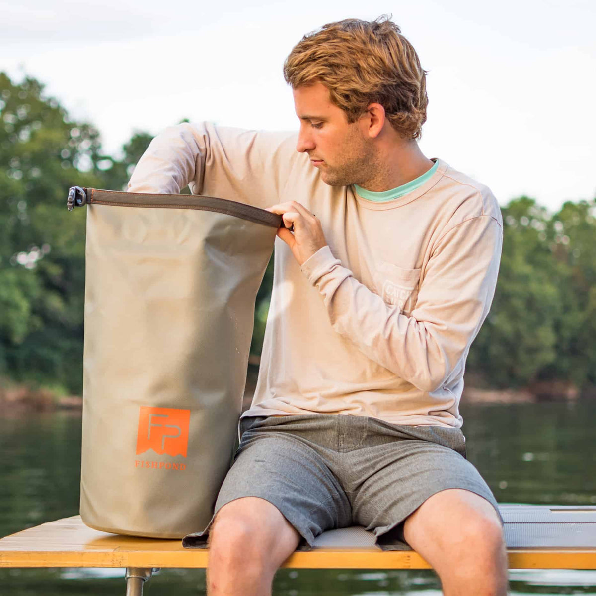 Fishpond Thunderhead Roll Top Dry Bag Shale On Boat With Person