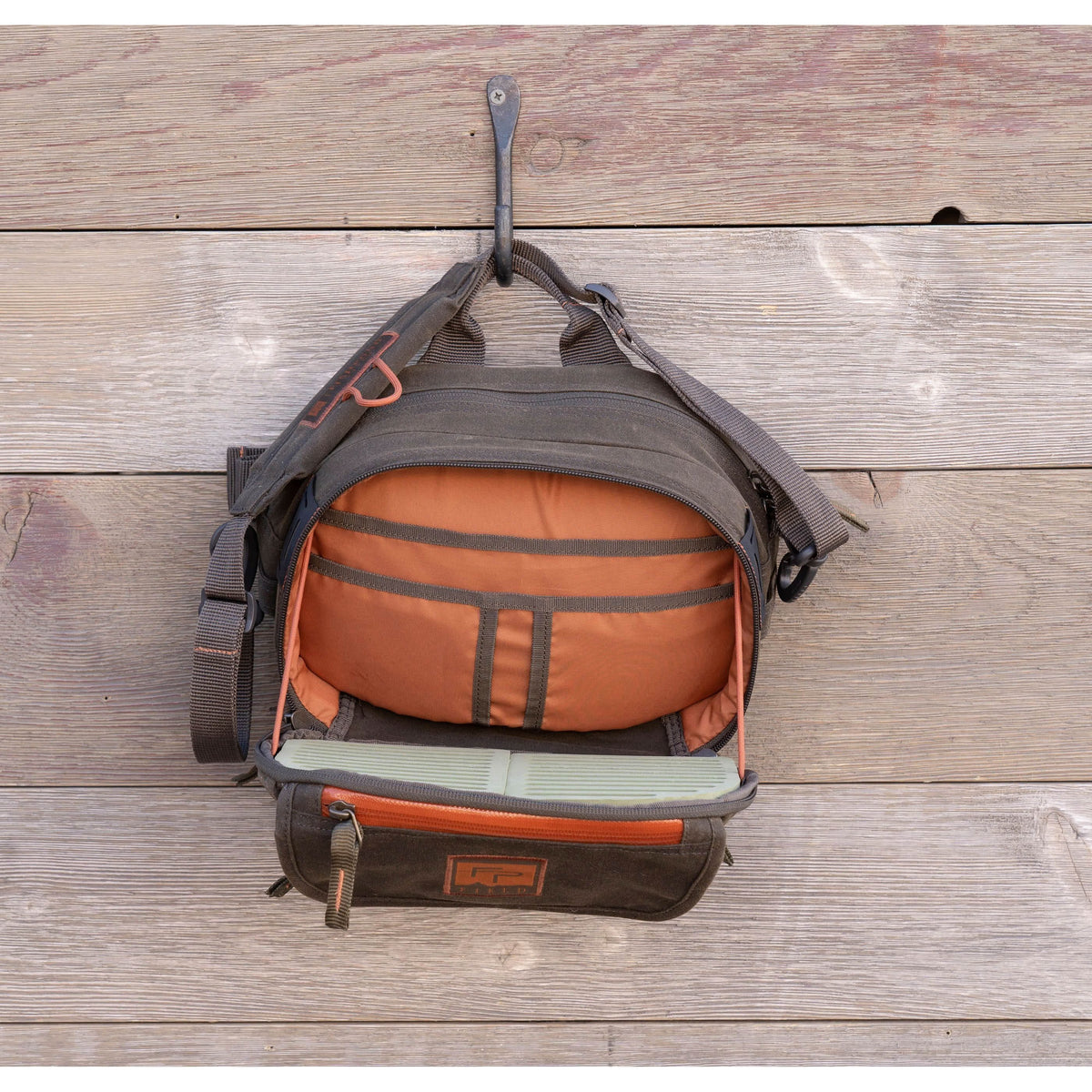 fishpond blue river peat moss lumbar pack chest pack waxed canvas fishing bag open