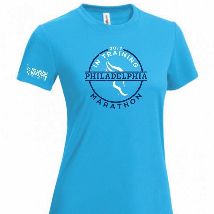 Philadelphia Marathon: '2017 In Training' Women's SS Tech Tee - Safety Blue <br><font color=#b3002d><b><i>Pre-order: ships in two weeks</i></b></font>