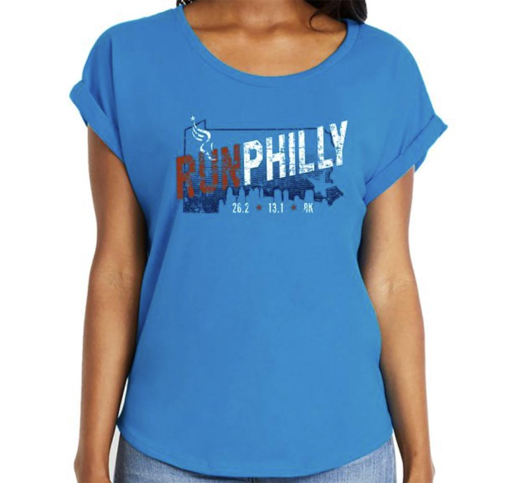 AACR Philadelphia Marathon: 'Run Philly' Women's SS Fashion Rolled Sleeve Tee - Turquoise - by Next Level