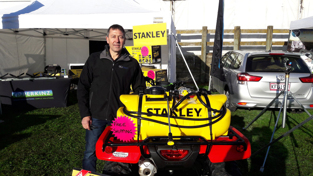 Load image into Gallery viewer, Wayne Perkins with the Stanley 12 volt sprayer range available in New Zealand