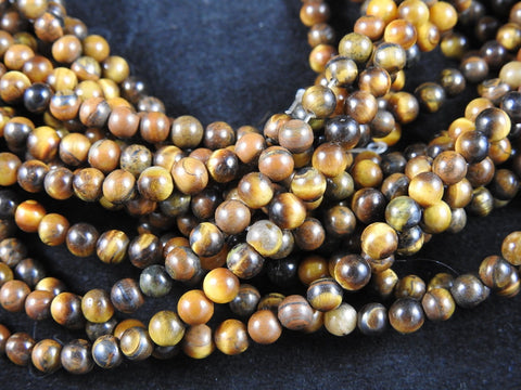 Tigers Eye (4-5mm Rounds) Bead Strand